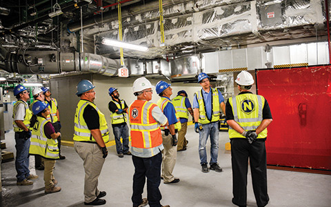 A team of construction workers inside a building